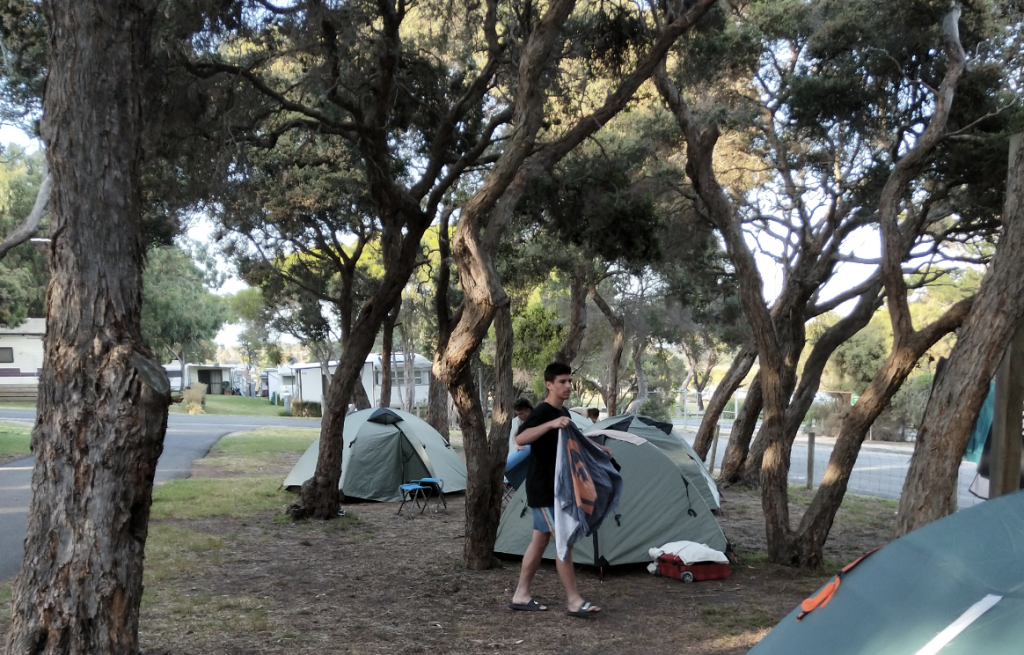 Student Setting up a tent at a camp ground
